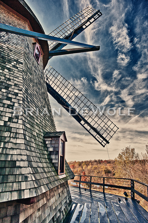 Windmill blades against a variegated autumn sky at the Fabyan Windmill in Geneva, Illinois.