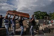 Brumadinho, Minas Gerais, Brazil, 28 Jan 2019:<br /> Funeral de Edymayra Coelho no cemitério municipal de Brumadinho. Edymayra era funcionária terceirizada da Vale S.A. e é mais uma vitima da tragédia.<br /> A barragem de rejeitos, que ficava na mina do Córrego do Feijão, em Brumadinho, se rompeu na sexta-feira (25). O mar de lama varreu a comunidade local e parte do centro administrativo e do refeitório da Vale. Entre as vítimas, estão pessoas que moravam no entorno e funcionários da mineradora. A vegetação e rios foram atingidos.<br /> Photo: Avener Prado