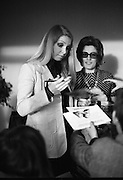 """Former Miss World Visits Dublin Zoo.<br /> 1973.<br /> 14.01.1973.<br /> 01.14.1973.<br /> 14th January 1973.<br /> Miss Eva Rueber-Staier, former Miss World from Austria and the """"World Wildlife Fund's Anniversary Girl"""", paid her first visit to Ireland to open the Shell/BP Irish Wildlife Promotion. As part of the promotion Eva paid a visit to Dublin Zoo in the Phoenix Park, Dublin.<br /> <br /> Miss Eva Rueber-Staier is pictured signing autographs during her visit to Dublin Zoo, she is seen wearing a panda badge the symbol of the World Wildlife Fund."""