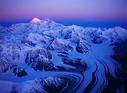 First light of sunrise illuminating the 20,320 foot summit of Mt. McKinley or Denali with the Eldridge Glacier below, Denali National Park, Alaska.