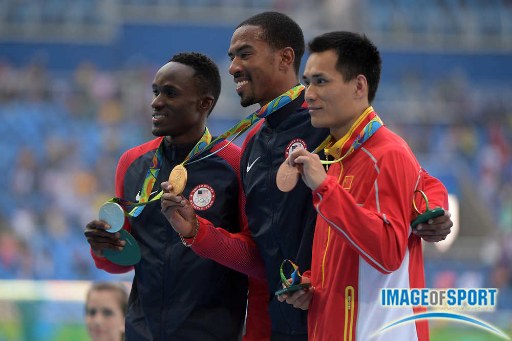 Aug 16, 2016; Rio de Janeiro, Brazil;  Will Claye (USA), Christian Taylor (USA) and Bin Dong (CHN) celebrate with their medals during the men's triple jump final in the Rio 2016 Summer Olympic Games at Estadio Olimpico Joao Havelange.