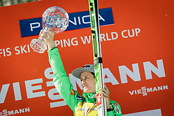 Overall World Cup winner Peter Prevc (SLO) celebrates with a globe after the Ski Flying Hill Team Competition at Day 4 of FIS Ski Jumping World Cup Final 2016, on March 20, 2016 in Planica, Slovenia. Photo by Ziga Zupan / Sportida