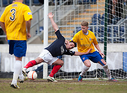 Falkirk's Sean Higgins tackled by Cowdenbeath's David Cowan.<br /> Falkirk 4 v 0 Cowdenbeath, 6/4/2013.<br /> ©Michael Schofield.