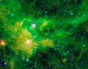 NASA's WISE captured this colorful image of the nebula BFS 29 surrounding the star CE-Camelopardalis, found hovering in the band of the night sky comprising the Milky Way.