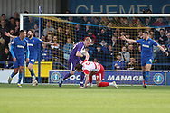Doncaster Rovers attacker John Marquis (9) fouling AFC Wimbledon goalkeeper Aaron Ramsdale (35) and getting second yellow card and sent off during the EFL Sky Bet League 1 match between AFC Wimbledon and Doncaster Rovers at the Cherry Red Records Stadium, Kingston, England on 9 March 2019.