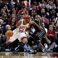29 January 2012: Chicago Bulls shooting guard Richard Hamilton (32) drives past Miami Heat shooting guard Dwyane Wade (3) during the Miami Heat 97-93 victory over the Chicago Bulls at the AmericanAirlines Arena, Miami, Florida, USA.