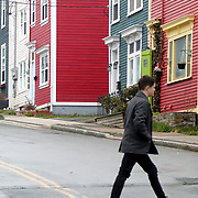"""A man walks in front of some of the """"jellybean houses"""" at Wood Street  and Duckworth Street in St. John's, Newfoundland and Labrador, Canada, on Monday, June 3, 2019. THE BLADE/KURT STEISS <br /> MAG NewfoundlandXX"""