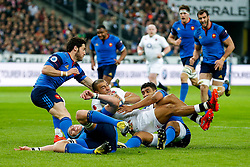 England Outside Centre Jonathan Joseph is tackled by France Winger Wesley Fofana - Mandatory byline: Rogan Thomson/JMP - 19/03/2016 - RUGBY UNION - Stade de France - Paris, France - France v England - RBS 6 Nations 2016.