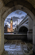 A view of Big Ben through an archway near Westminster Bridge in London.