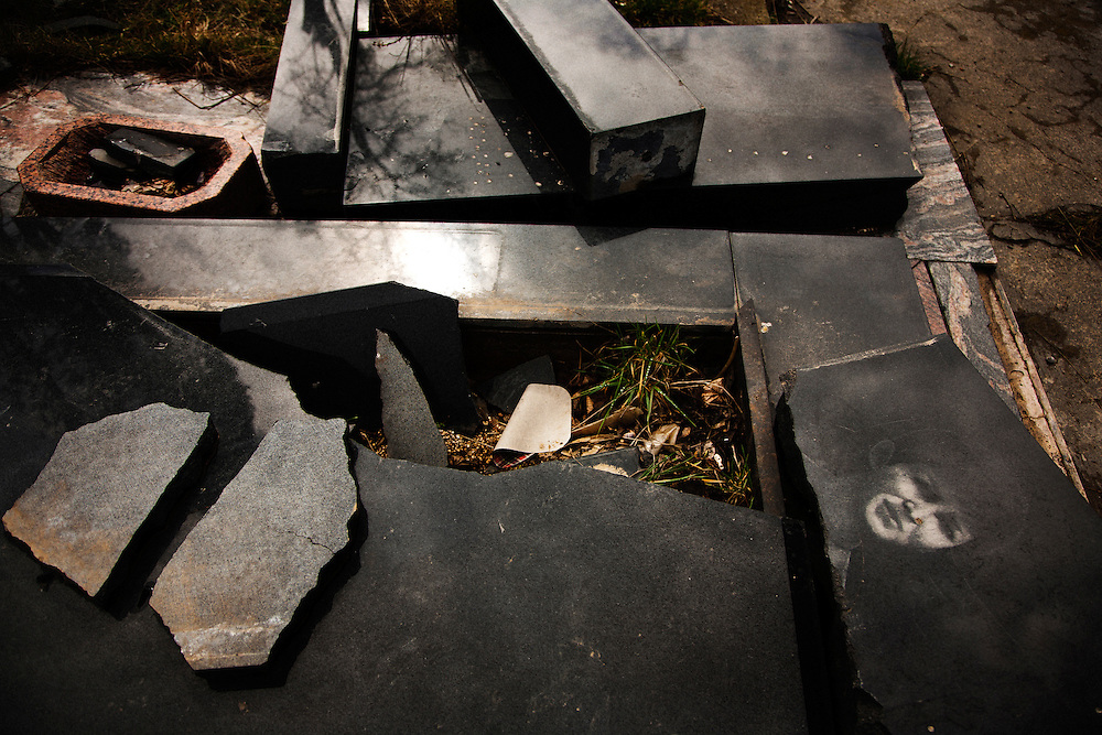 A destroyed grave in a Serbian Orthodox cemetery in Albanian-controlled south Mitrovica, Kosovo. March 2011.