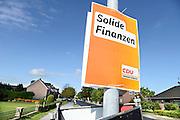 Duitsland, Germany, Deutschland, Kranenburg, 9-9-2013Nationale verkiezingen in de Bondsrepubliek. Poster van de CDU hangt aan lantaarnpaal. Economie en ginancien zijn een belangrijk thema.Foto: Flip Franssen/Hollandse Hoogte