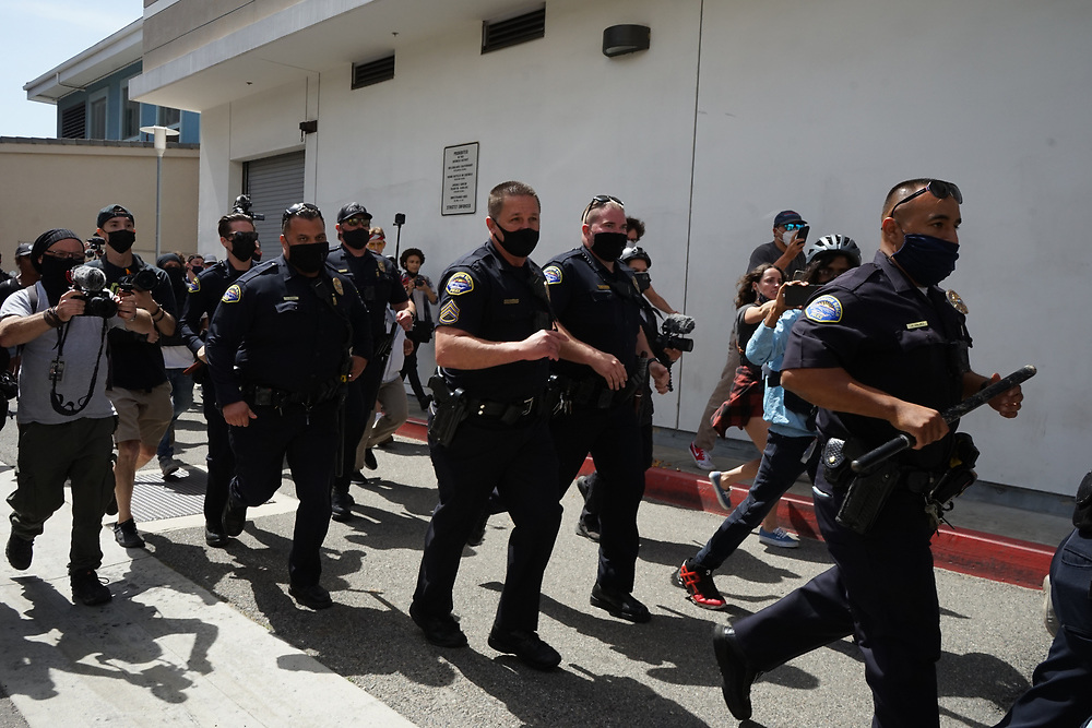 """Sunday April 11th in Huntington Beach a """"white lives matter"""" rally was planned for the pier but only a few showed up and the ones that did were met by the counter protest. Through out the day 12 people were arrested at the protests, according to a press release from the city. The protest was declared an unlawful assembly around 2:36 p.m."""