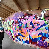 Nederland, Amsterdam , 13 februari 2010..Aileen Esther Middel aka Mickey, alias Micklarock is graffiti kunstenares...Op de foto staat Micklarock in Amsterdam Zuid Oost in Kraaienest bij een graffitti wand waar zij deels zelf aan gewerkt heeft.Foto:Jean-Pierre Jans
