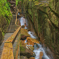 New England photography of the Flume Gorge in the Franconia Notch State Park and New Hampshire White Mountains.<br /> <br /> Beautiful New Hampshire fine art photography of a hiking trail in the New Hampshire White Mountains Flume Gorge are available as museum quality photography prints, canvas prints, acrylic prints, wood prints or metal prints. Fine art prints may be framed and matted to the individual liking and interior design decorating needs:<br /> <br /> https://juergen-roth.pixels.com/featured/hiking-in-the-new-hampshire-white-mountains-flume-gorge-juergen-roth.html<br /> <br /> Good light and happy photo making!<br /> <br /> My best,<br /> <br /> Juergen