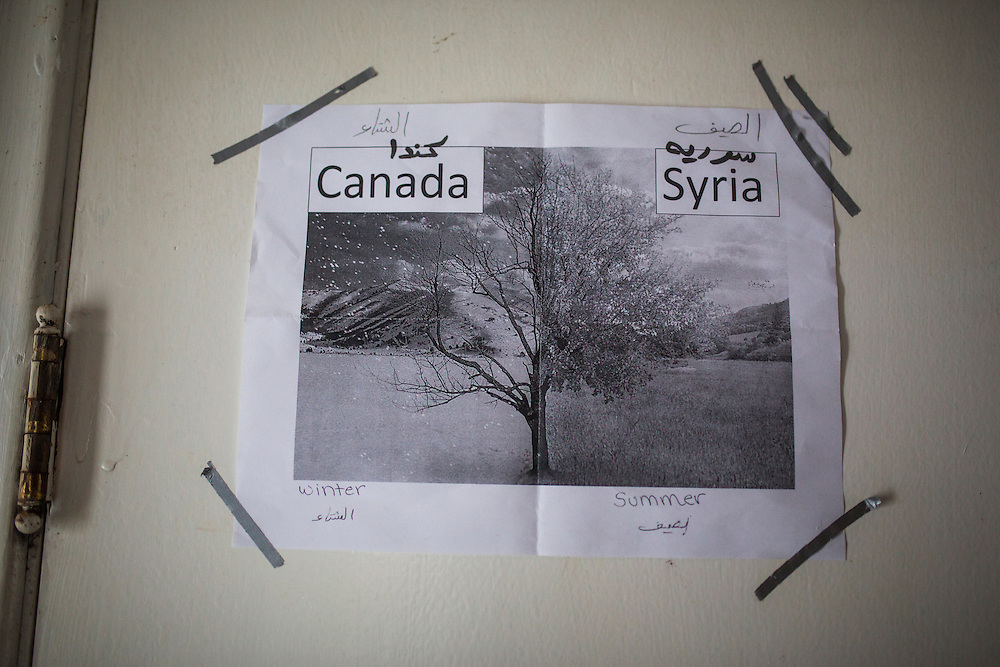 A picture is printed and stuck on the wall inside their temporary home in Picton, Ontario, Canada, Wednesday January 20, 2016.   (Mark Blinch for the BBC)