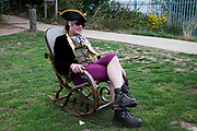 A man dressed as a pirate sits in a rocking chair in East London. He was later joined by many more friends all dressed as pirates.