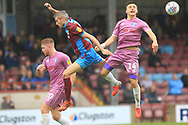 Matty Lund and Ollie Rathbone during the EFL Sky Bet League 1 match between Scunthorpe United and Rochdale at Glanford Park, Scunthorpe, England on 8 September 2018.