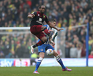 Norwich City's striker Cameron Jerome beats Greg Halford, Brighton defender during the Sky Bet Championship match between Brighton and Hove Albion and Norwich City at the American Express Community Stadium, Brighton and Hove, England on 3 April 2015.