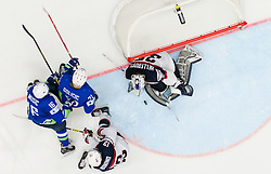 Ales Music of Slovenia, Bostjan Golicic of Slovenia vs Nick Bonino of USA and Connor Hellebuyck of USA during Ice Hockey match between Slovenia and USA at Day 10 in Group B of 2015 IIHF World Championship, on May 10, 2015 in CEZ Arena, Ostrava, Czech Republic. Photo by Vid Ponikvar / Sportida