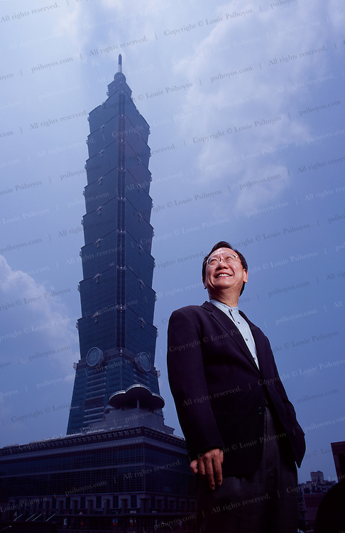 """World-renowned architect CP Wang of CY Lee & Partners stands in front of Taipei 101, which at 508 meters, stands the tallest building in the world. The jade green bamboo-inspired exterior connotes vigor and sturdiness in Chinese culture. Good idea for a tower that stands 200 meters from a major fault line in a city prone to typhoons. Lee designed eight stories to each of the eight segments because the number """"8"""" signifies prosperous growth. Each segment is shaped like a scepter, with ancient coins on the exterior of the 26th floor to give this modern building a Chinese style."""