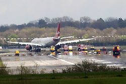 © Licensed to London News Pictures. 16/04/2012, London, UK.  A Virgin Atlantic plane sits on the runway at London Gatwick Airport after forced to make an emergency landing after smoke was reported in the cabin. Monday, April 16, 2012. The Virgin Atlantic VS27 was bound for Orlando in the US from Gatwick Airport. Photo credit : Sang Tan/LNP