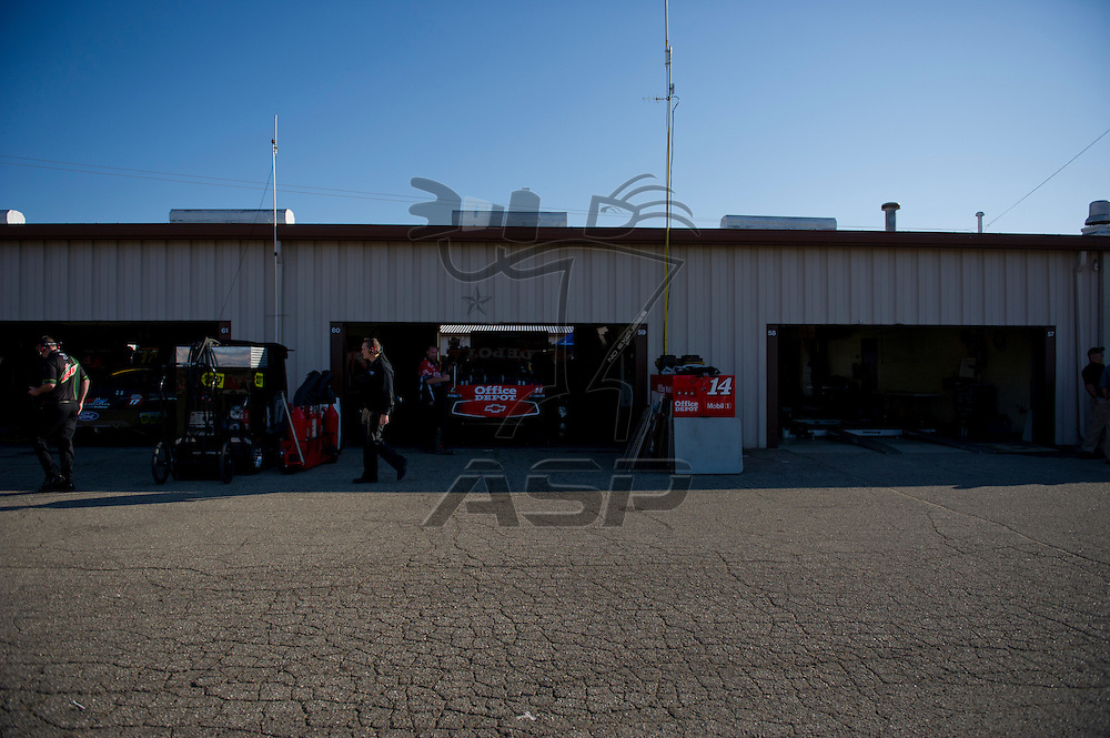 Brooklyn, MI - JUN 14, 2012:  The NASCAR Sprint Cup teams work in the garage during the first test session for the Quicken Loans 400 race at the Michigan International Speedway in Brooklyn, MI.