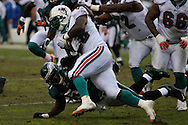 PHILADELPHIA - NOVEMBER 18: The Philadelphia Eagles defense attempts a tackle during the game against the Miami Dolphins on November 18, 2007 at Lincoln Financial Field in Philadelphia, Pennsylvania.