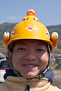A festival official wearing a safety helmet with a rubber duck on top during the Ashigara River festival, Kintaro duck-race in Matsuda, Kanagawa, Japan April 25th 2010