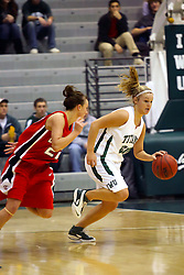 10 January 2009: Holly Harvey races past Heather Gilmore. The Illinois Wesleyan Titans, ranked #1 in the latest USA Today/ESPN poll, take down the Lady Reds of Carthage and remain undefeated,  2-0 in the CCIW and over all to 12-0. This is the first time in the history of the Lady Titans Basketball they have been ranked #1 The Titans and Lady Reds played in the Shirk Center on the Illinois Wesleyan Campus in Bloomington Illinois.