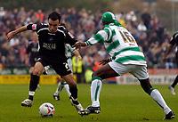 Photo: Alan Crowhurst.<br />Yeovil Town v Swansea. Coca Cola League 1. 08/10/2005. Swansea's Leon Britton (L) takes on Efetobore Sodje.