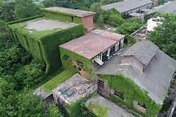 June 20, 2017 - Huai'An, Huai'an, China - Huai'an, CHINA-June 20 2017: (EDITORIAL USE ONLY. CHINA OUT) The abandoned factory is blanketed by green vines in Huai'an, east China's Jiangsu Province, June 20th, 2017. (Credit Image: © SIPA Asia via ZUMA Wire)