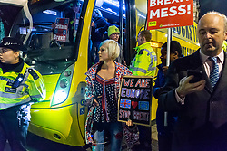 "A cpro-Remain campaigners disembark a bus emblazoned with ""Bollox to Brexit"" as it arrives at Steve Bray's ongoing pro-remain protest at Old Palace Yard outside Parliament. Westminster, London, December 20 2018."