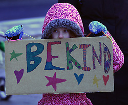 """December 10, 2016 - Washington, DC, USA - VIOLET KENT, 7 years old, from DC holds a sign saying ''Be Kind.'' Children's Rally for Kindness takes place at Trump International Hotel in Washington DC on December 10, 2016 organized by the Takoma Parents Action Coalition.  According to their FaceBook page, it was a call to President-elect Donald Trump: ''to remember these lessons as he prepares to take office and implement policies that will affect the lives of children and families across our diverse nation.''.''All over the world, across cultures and countries, children learn the same basic lessons: .Ã'be kind,Ã"""" .Ã'tell the truth,Ã"""" .Ã'be fair,Ã"""" .Ã'respect everyone,Ã"""" .Ã'treat others the way you want to be treated,Ã"""" .Ã'donÃ•t touch others if they donÃ•t want to be touched. (Credit Image: © Carol Guzy via ZUMA Wire)"""