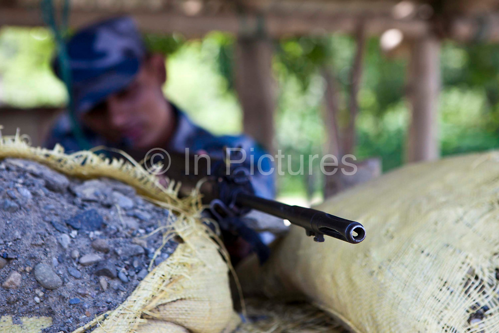 A Nepali army officer on guard at the India / Nepal boarder crossing at Belahiya.