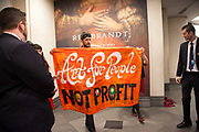 'BP or not BP' and 'Shell Out Sounds' make a joint intervention against the sponsorship by SHELL of the Rembrandt exhibition due to open the following day atthe National Gallery.  The intervention was about the sponsorship of oil money and the looming privatisation of British galleries. At one point the narrator of the show sings: ' Museum man, he bought their plan / to sell his staff to private hands / make deals with corporate monsters / like Shell the oily sponsor'. The show was cut short by staff and all were peacefully ejected from the lobby and into the street. The intervention was part of an ongoing campaign against oil sponsorship of British public institutions like the National Gallery and the Tate galleries.