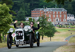 © Licensed to London News Pictures. 13/07/2015. Epsom, UK. SEREN and ELISE WHYTE (corrrect spelling) set off in their 1934 Austin Seven Super 750. The start of The Royal Automobile Club 1000 Mile Trial 2015 at Woodcote Park in Epsom, Surrey. The event, which starts and finishes at Woodcote Park, takes a fleet of over 40 classic cars from around the world, through a 1000 mile trial around the UK.  Photo credit: Ben Cawthra/LNP