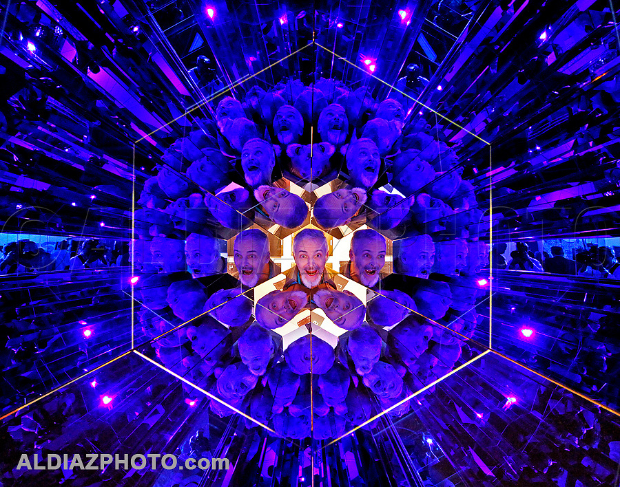 """Cherkashin Valera looks through a sculpture by artist Olafur Eliasson titled """"Your Blue Planet"""" during Art Basel Miami Beach at the Miami Beach Convention Center on Wednesday, November 30, 2011."""