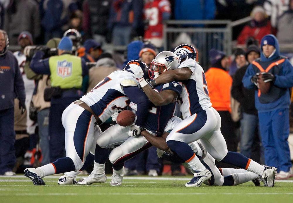 Foxborough, MA 01/14/2012.Patriots running back Stevan Ridley fumbles the ball in the second half of  Saturday's AFC Divisional game between the New England Patriots and the Denver Broncos..Wicked Local Photo by Alex Jones
