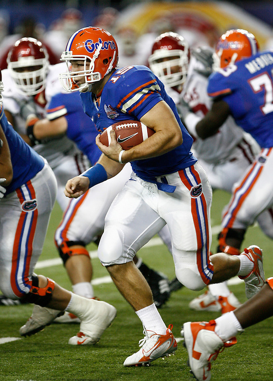 Florida QB Tim Tebow runs through the line of scrimmage during the SEC Championship game between the Arkansas Razorbacks and the Florida Gators at the Georgia Dome in Atlanta, GA on December 2, 2006.<br />