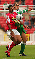 Fotball<br /> England 2005/2006<br /> Foto: SBI/Digitalsport<br /> NORWAY ONLY<br /> <br /> Swindon v Yeovil<br /> Coca Cola League 1.<br /> 27/08/2005.<br /> <br /> l-r Swindon's Jerel Ifil and Yeovil's Paolo Bastianini battle is out for the ball.