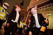 8 men dressed in tuxedos and wearing pigs heads tried to join the Lord Mayor's Banquet in London, pointing out that the banquet is for the 1 % of society and not the 99%. The police rejected the pig's invites and no arrests were made. The distinguished pig men are said to be from the Willingdon club and eventually they moved on to the join the Occupy LSX at St Paul's Cathedral.