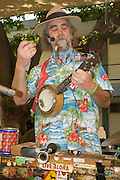 A music performance and demonstration by a musician who uses recycled trash and garbage to manufacture his musical instruments to raise environmental awareness