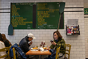 Customers eating and using mobile technology at the Rock and Sole Plaice traditional fish and chip restaurant on the 27th September 2019 in London in the United Kingdom.