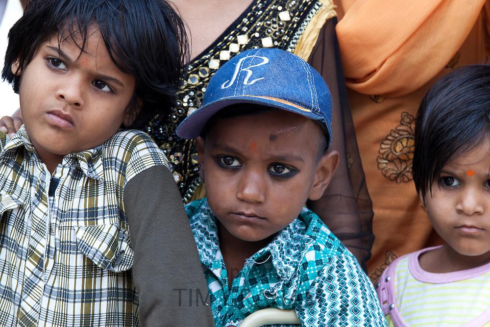 Indian children in back of truck at Mehrauli, New Delhi, India