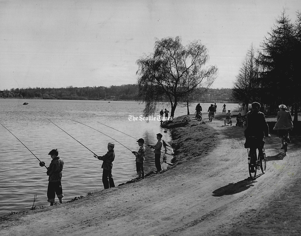 Great fun at Green Lake: One of Seattle's most popular places for outings during pleasant weather is Green Lake. Children flock there on foot, bicycles and tricycles. Some take their fishing rods.  (Josef Scaylea / The Seattle Times, 1950)