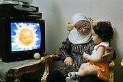 Watching Teletubbies TV show in Cairo, Egypt.