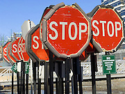 many stop signs at a storage depot