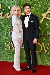 Pixie Lott and Oliver Cheshire attending the Fashion Awards 2017, in partnership with Swarovski, held at the Royal Albert Hall, London. Picture Date: Monday 4th December, 2017. Photo credit should read: Matt Crossick/PA Wire