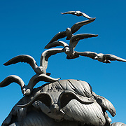 The seagulls atop the Navy-Merchant Marine Memorial in Arlington, Virginia, on Columbia Island on the banks of the Potomac across from Washington DC. The memorial honors those who lost their life at sea in World War I and was dedicated in 1934. The main sculpture is cast from aluminum.