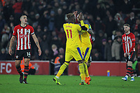 Football - 2018 / 2019 Premier League - Southampton vs. Crystal Palace<br /> <br /> Jordan Ayew of Crystal Palace pushes Wilfried Zaha of Crystal Palace away from Referee Mr Andre Marriner after the palace player received a red card for sarcastically applauding his yellow card at St Mary's Stadium Southampton<br /> <br /> COLORSPORT/SHAUN BOGGUST